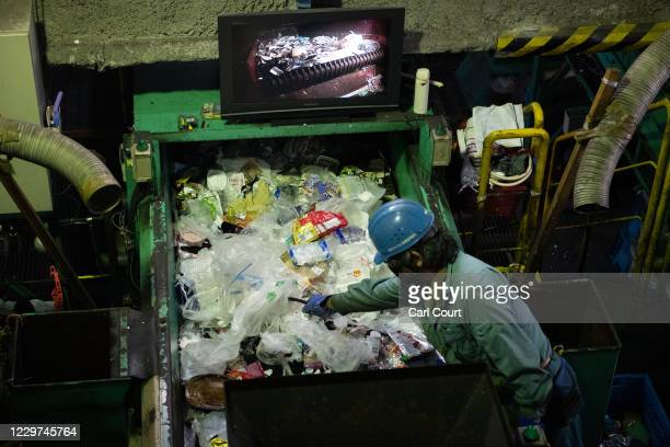 A worker sorts through plastic household waste at Minato plastic household waste at Minato Resource Recycle Centre on November 19 2020 in Tokyo Japan...