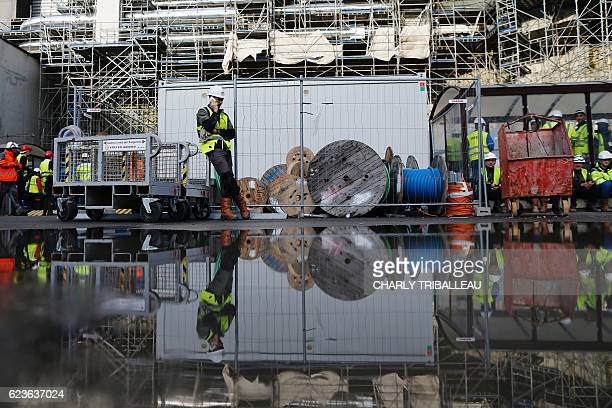 A worker speaks on the phone in the construction site of the thirdgeneration European Pressurised Water nuclear reactor in Flamanville northwestern...