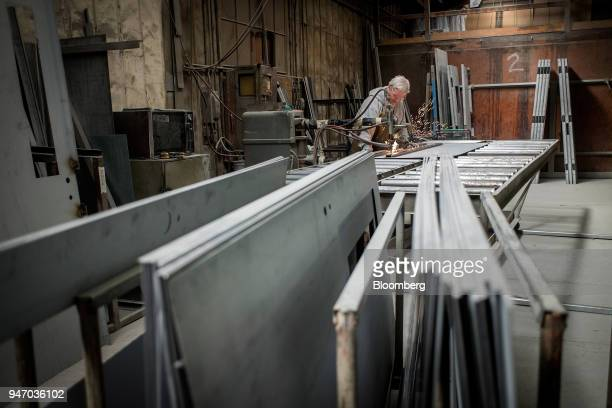A worker spot welds a brace to a door at the Metal Manufacturing Co facility in Sacramento California US on Thursday April 12 2018 The Federal...
