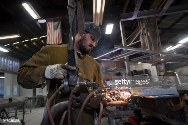 A worker spot welds a metal door during production at the Metal Manufacturing Co facility in Sacramento California US on Thursday April 12 2018 The...