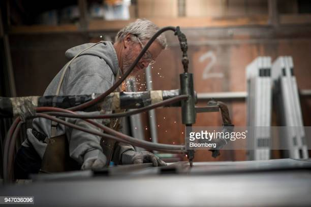 A worker spot welds braces to a door at the Metal Manufacturing Co facility in Sacramento California US on Thursday April 12 2018 The Federal Reserve...