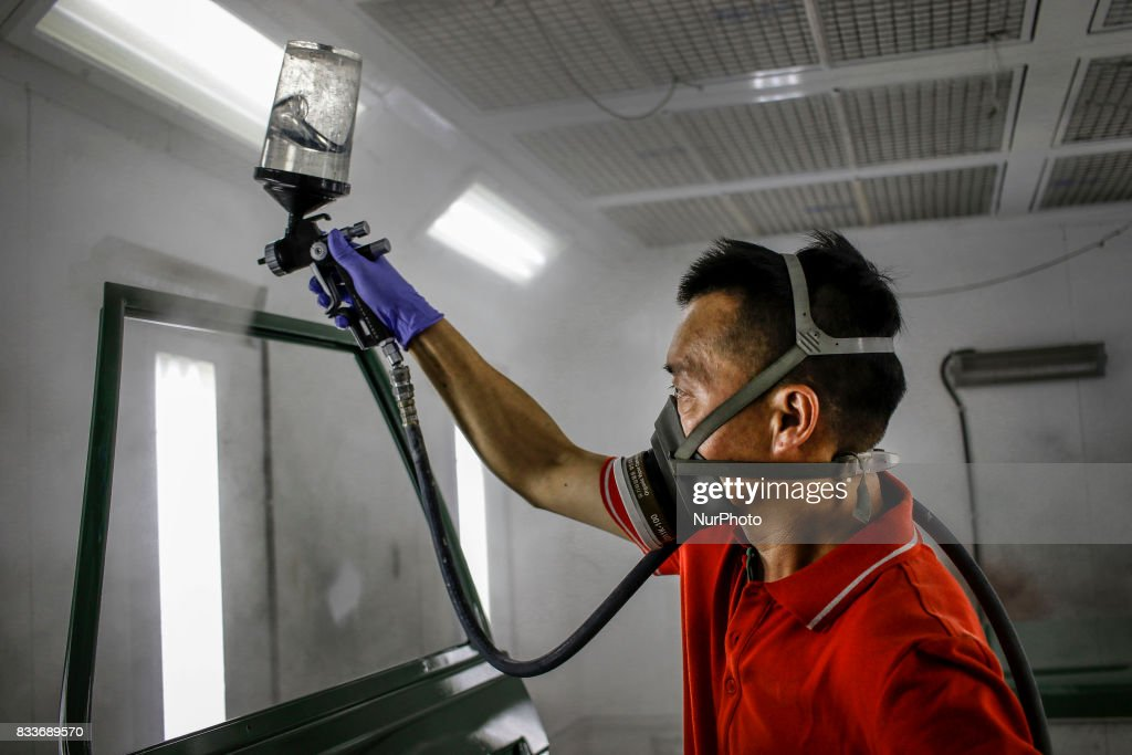 """Worker spraying bonnet at paint room of mehenic garages in Paju, South Korea. A 20-year-old beat up Hyundai SUV isn't anyone's idea of a dream car. But used Hyundai Gallopers, priced between $2,000 to $3,000 at second-hand car markets, are making a comeback , reborn as upwards $80,000 luxury vehicles at the hand of former furniture designer Henie Kim. Kim is now the CEO of Mohenic Garages, a car rebuilding company based in Paju has transformed the boxy classic into one of South Korea's most highly-desired cars. """"As a former designer, I wanted make everything perfect."""" The remade """"Mohenic G"""", as they're known, take their design cues from the 1990s and come in a variety of custom colors from """"mint racing green"""" to """"midnight cerulean blue"""". Demand for the """"Mohenic G"""" has steadily risen, and the waitlist is long. Since 2013, only 43 cars have been rebuilt and 48 customers are on a waiting list. Production is slow though since the company expanded, they're able to produce 30 cars a year, or about 2 cars a month. A team of two dozen workers transform each car in a meticulous process that includes prying the car cabin from its frame, sanding, removing corrosive substances, polishing and painting."""