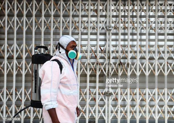 A worker sprays disinfectant as a preventive measure against the spread of COVID19 on March 25 2020 in Sharjah United Arab Emirates The Coronavirus...