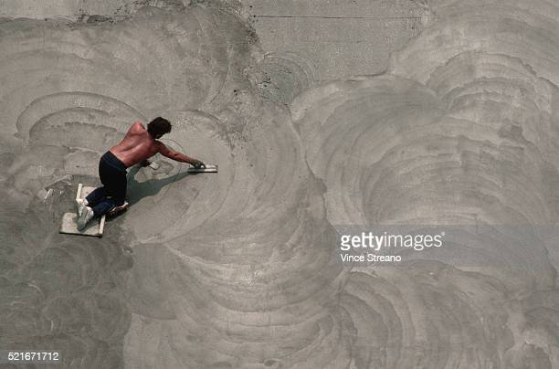 Worker Spreading Cement