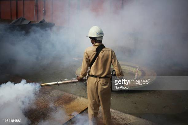 A worker srays pesticide to kill mosquitoes in Dhaka Bangladesh on 25 August 2019 Since 1 January 2019 to 17 august 2019 A total number of 51476 have...
