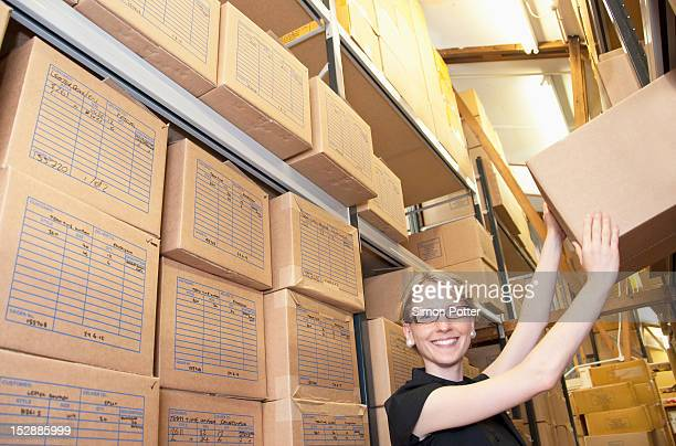 Worker stacking cardboard boxes