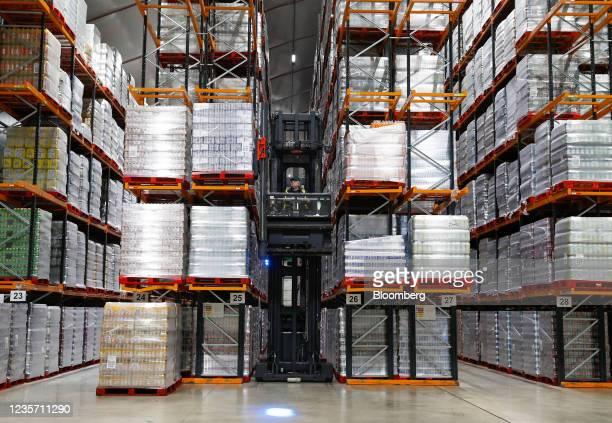 Worker stacks pallets of drinks at the Refresco soft-drink bottling factory in Kegworth, U.K., on Tuesday, Oct. 5, 2021. PAI Partners is considering...