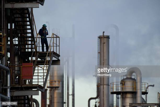 A worker stand on a flight of steps at a chemical plant in the Keihin industrial area of Kawasaki Kanagawa Prefecture Japan on Tuesday Dec 12 2017...