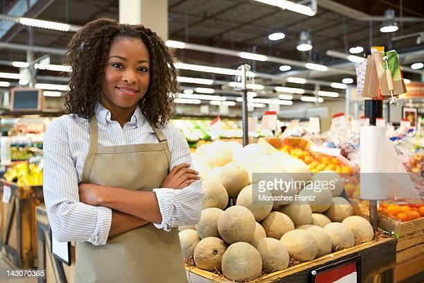 Worker standing in supermarket