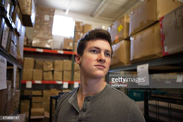 worker standing in warehouse - heshphoto stock pictures, royalty-free photos & images