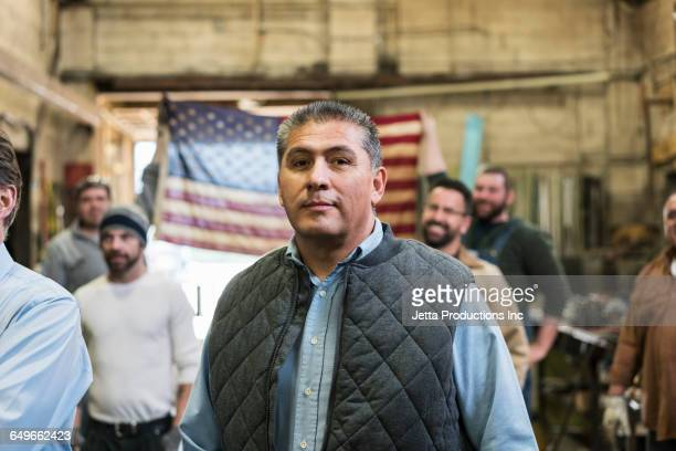 worker standing in workshop - patriotic stock pictures, royalty-free photos & images