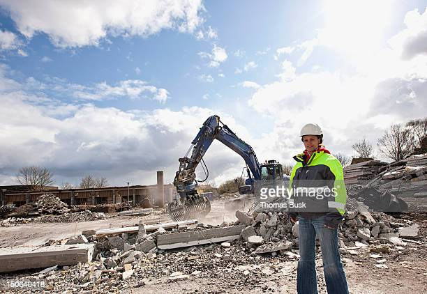 worker standing on construction site - demolishing stock pictures, royalty-free photos & images