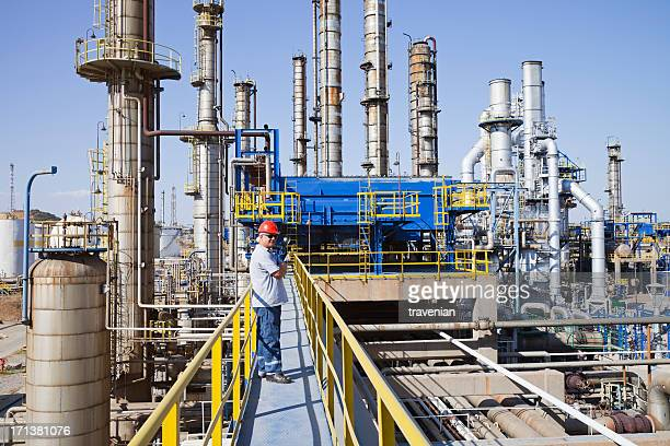 worker standing on deck of petrochemical plant - gas refinery stock photos and pictures