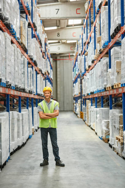 Worker Standing With Arms Crossed At Warehouse