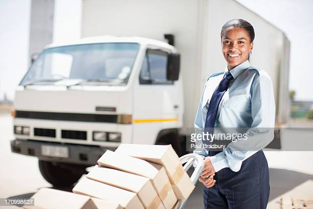 worker standing with stack of boxes - postal worker stock pictures, royalty-free photos & images