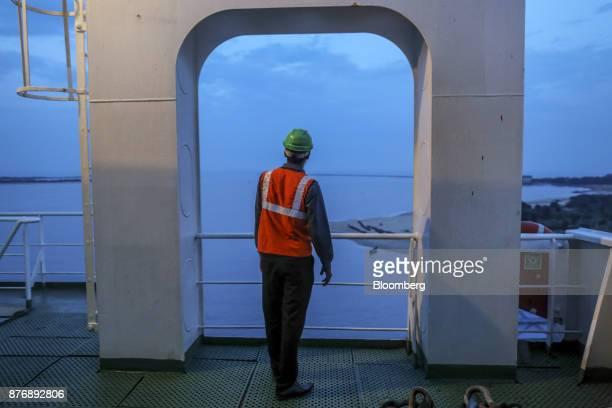 A worker stands aboard the Da Dan Xia cargo ship at Krishnapatnam Port in Krishnapatnam Andhra Pradesh India on Monday Aug 11 2017 Growth in gross...