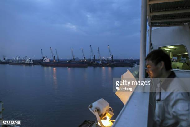 A worker stands aboard the Da Dan Xia cargo ship docked at Krishnapatnam Port in Krishnapatnam Andhra Pradesh India on Friday Aug 11 2017 Growth in...