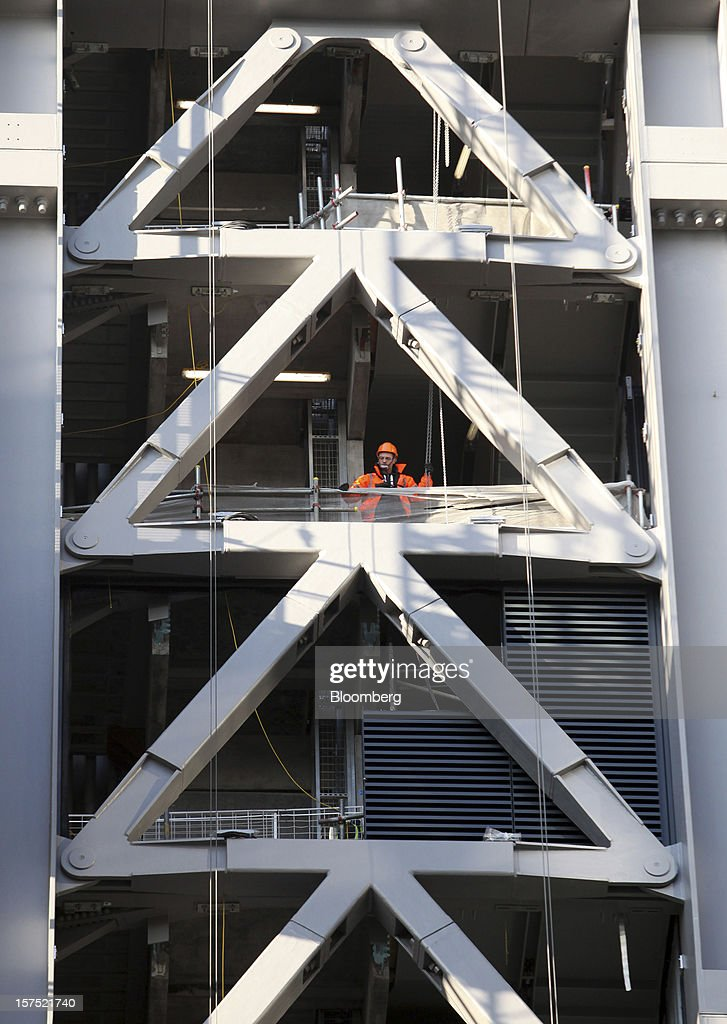 A worker stands amongst the metal structure of the Leadenhall building during construction in London, U.K., on Friday, Nov. 30, 2012. U.K. banks have become more unwilling to finance development projects without a tenant committed to lease space or a buyer for the completed property. Photographer: Chris Ratcliffe/Bloomberg via Getty Images