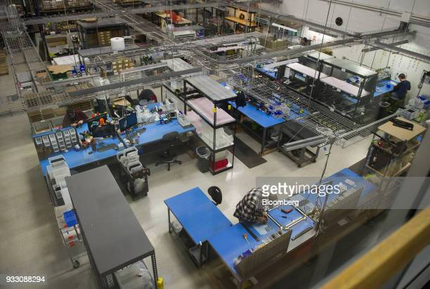 A worker stands at a station in the assembly and quality control department at the Aleph Objects Inc LulzBot 3D printers production facility in...