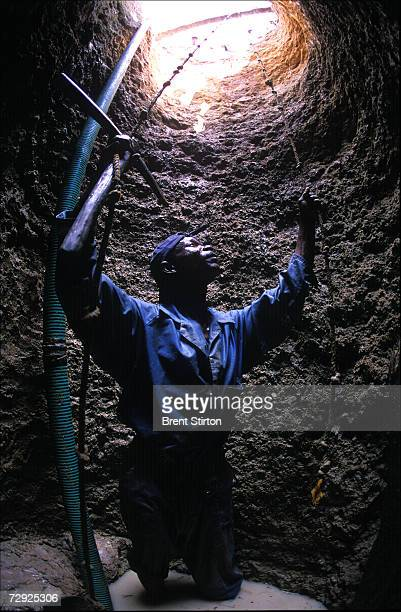 A worker stands at the bottom of a newly dug well sponsored by a British NGO The presence of the new well means that disease is reduced women have...