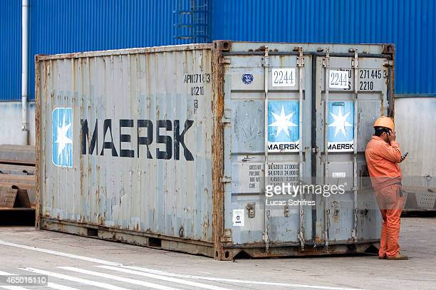 A worker stands by a Maersk container outside the workshops of Shanghai Zhenhua Port Machinery Co Ltd on December 8 2009 in Changxing Island Shanghai...