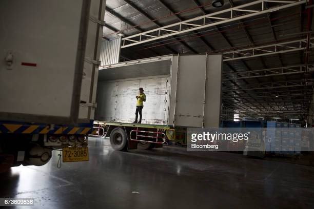 A worker stands in a truck in a loading area of the Nissan Motor Co plant in Samut Prakan Thailand on Tuesday April 25 2017 Nissan andMitsubishi...