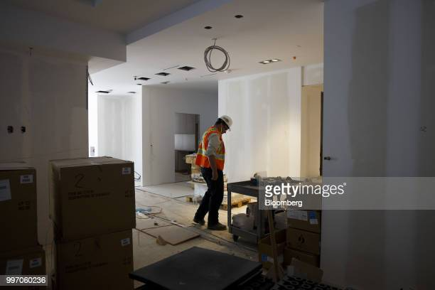 A worker stands in a unit during construction of the GWL Realty Advisors Livmore luxury apartment building in Toronto Ontario Canada on Tuesday July...