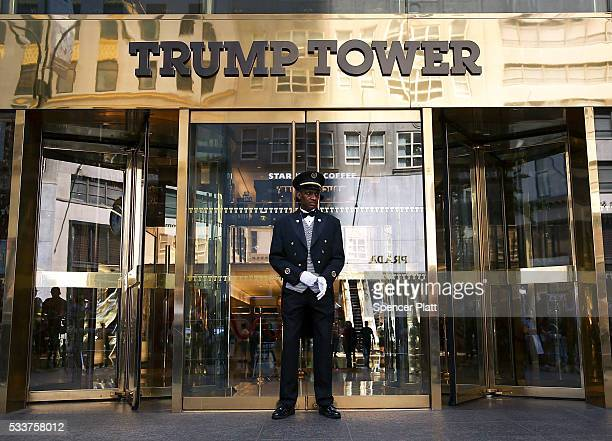A worker stands in front of Trump Tower as a group of veterans protest on May 23 2016 in New York City The group of veterans are alleging that...