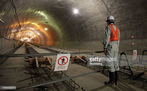 A worker stands in the Akiyama tunnel which is under construction for Central Japan Railway Co's magneticlevitation train line in Uenohara City...
