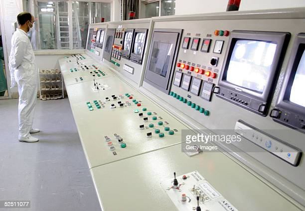 Worker stands inside of an uranium conversion facility March 30, 2005 just outside the city of Isfahan, about 254 miles , south of capital Tehran,...
