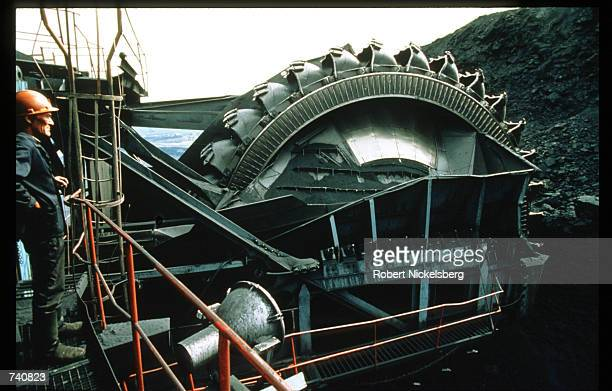 A worker stands near a coal pit September 1994 in Ekibastuz Kazakhstan Kazakhstan contains vast mineral resources and has a large reserve of...