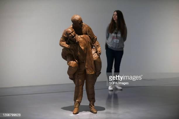 """Worker stands next to a sculpture during the exhibition. """"De Miró a Barceló. Un siglo de arte español"""" exhibition at Centre Pompidou Museum,..."""