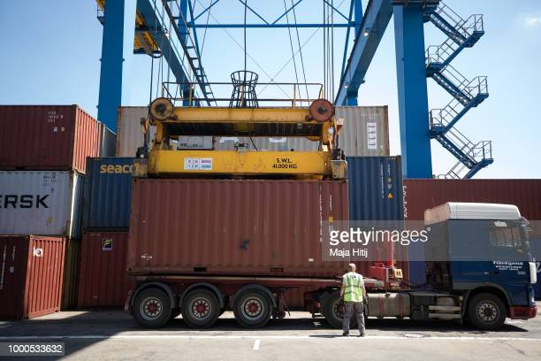 Worker stands next to the containers at terminal in the Duisburg port on July 16 2018 in Duisburg Germany Approximately 25 trains a week use the Silk...