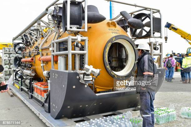 A worker stands next to the US Navy deep diving rescue vehicle the Pressurized Rescue Module mobilized to support the Argentine government's search...