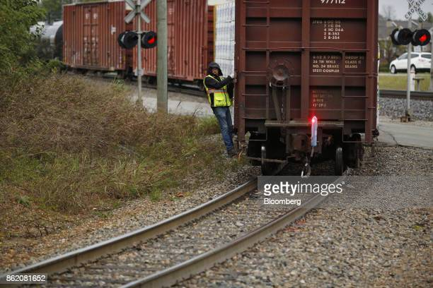 A worker stands on a CSX Corp freight train in Louisville Kentucky US on Sunday Oct 15 2017 CSX is scheduled to release earnings figures on Oct 17...
