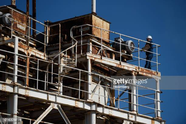 A worker stands on a flight of steps at a plant in Nagoya Japan on Tuesday July 31 2018 Japan is scheduled to release trade balance figures for July...