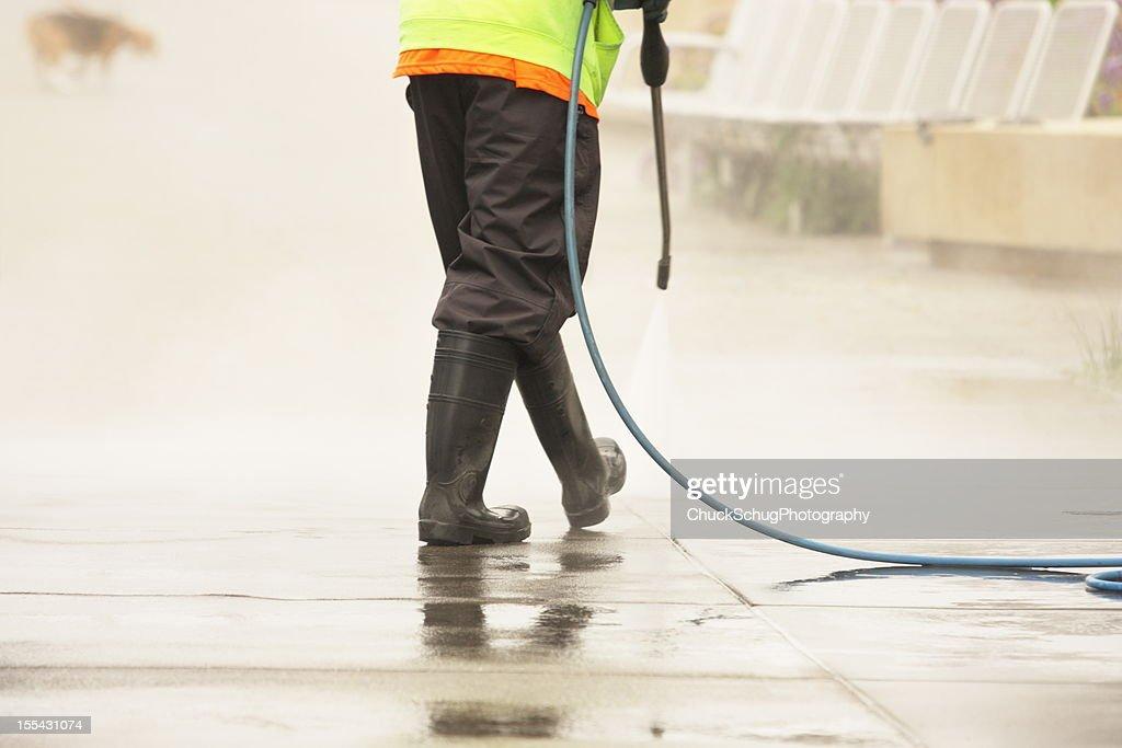Worker Steam Cleans Sidewalk Dog : Stock Photo