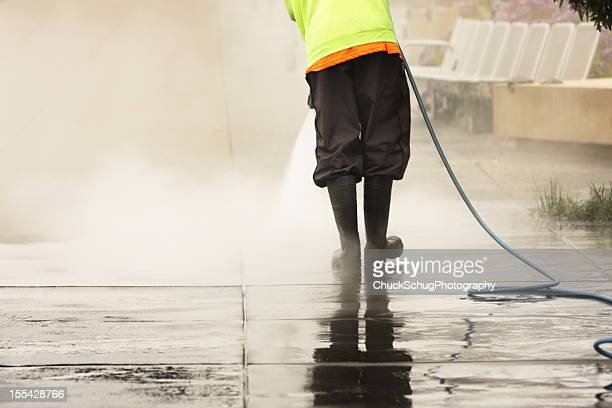 worker steam cleans sidewalk - power in nature stock pictures, royalty-free photos & images