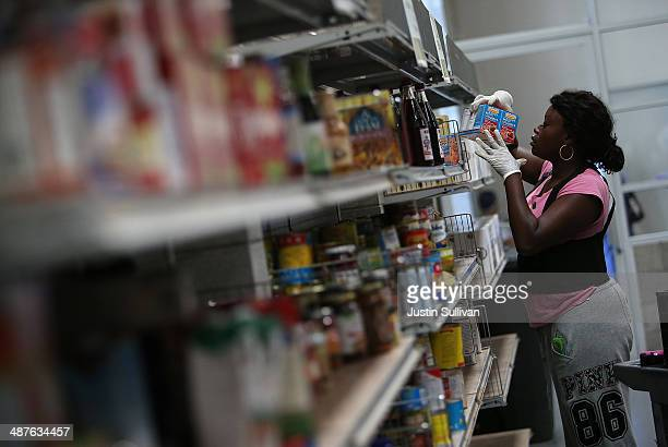 A worker stocks shelves with canned goods at the SFMarin Food Bank on May 1 2014 in San Francisco California Food banks are bracing for higher food...