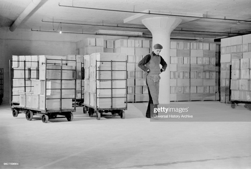 Worker Storing Crates of Eggs in Cold Storage Warehouse, Jersey City