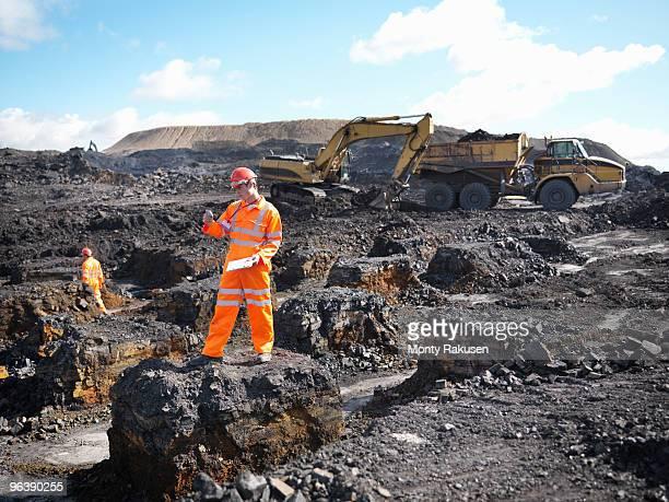 Worker Surveying Coal Mine
