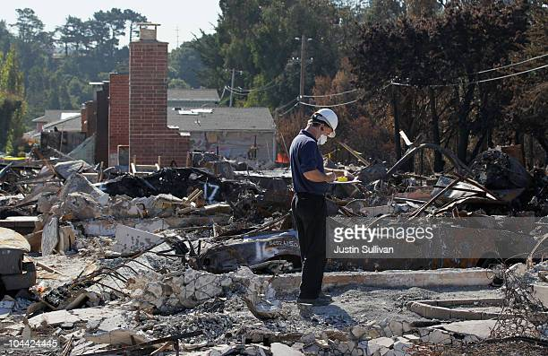 A worker surveys a burned home near the epicenter of the gas line explosion that devastated a neighborhood near San Francisco International Airport...