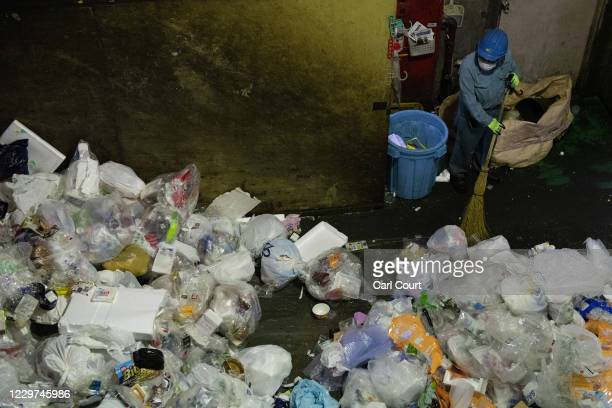 A worker sweeps plastic household waste at Minato plastic household waste at Minato Resource Recycle Centre on November 19 2020 in Tokyo Japan...