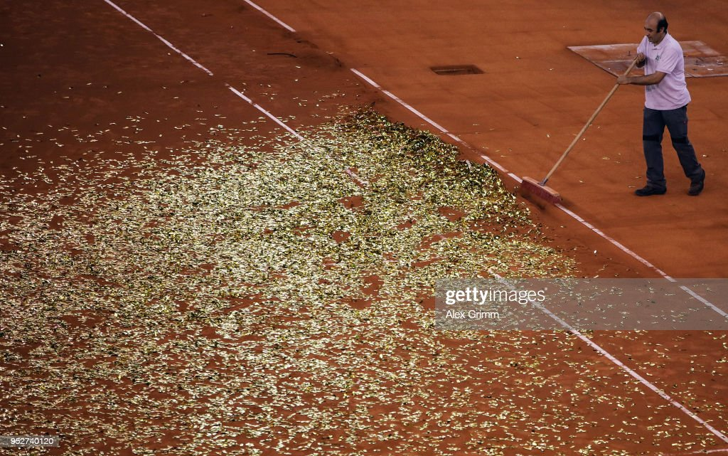 A worker sweeps sand and confetti on the centre court after the last match on day 7 of the Porsche Tennis Grand Prix at Porsche-Arena on April 29, 2018 in Stuttgart, Germany.