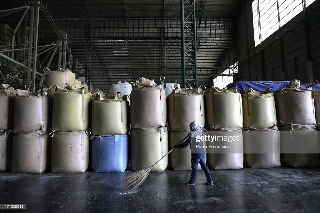 A worker sweeps the floor next to rice stored in giant bags at the Settapanich -Samchuk rice mill in on June 20, 2013 in Suphan Buri, Thailand. Thailand plans to sell as much as 7 million metric tons from inventories in order to fund a grain purchase program. Recently financial sources revealed that the actual losses from the government's controversial rice pledging scheme for the 2011-12 rice harvest year are close to reaching 200 billion baht [US$6.5 billion], this is far above the Thai Finance Ministryâs earlier forecast of 70-100 billion baht.