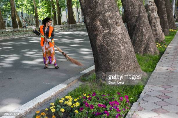 A worker sweeps the road on Rudaki Avenue in Dushanbe Tajikistan on Saturday April 21 2018 Flung into independence after the Soviet Union collapsed...