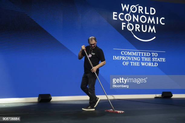 A worker sweeps the stage in a session hall at the Congress Center during preparations ahead of the World Economic Forum in Davos Switzerland on...