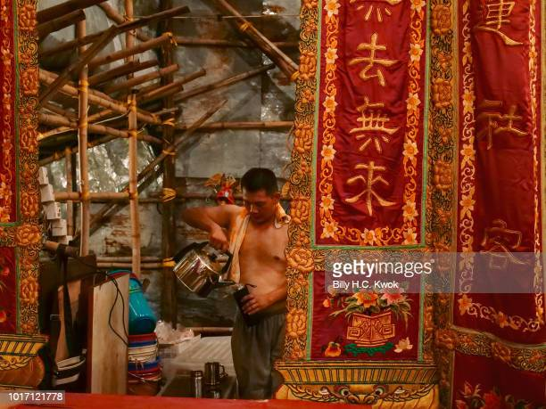 A worker take a break backstage while he prepare for the month of Hungry Ghost Festival on August 10 2018 in Hong Kong The Yu Lan Festival one of...