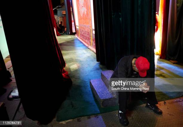 A worker take a nap after Fen Sheng Hui Theatre's last performance in Sunbeam Theatre Sunbeam Theatre where Feng Sheng Hui Theatre preforms their...