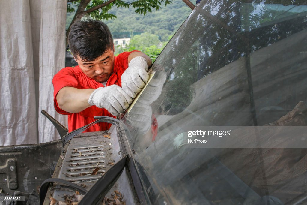 """Worker take apart old gallopper vehicle at mohenic garages yard in Paju, South Korea. A 20-year-old beat up Hyundai SUV isn't anyone's idea of a dream car. But used Hyundai Gallopers, priced between $2,000 to $3,000 at second-hand car markets, are making a comeback , reborn as upwards $80,000 luxury vehicles at the hand of former furniture designer Henie Kim. Kim is now the CEO of Mohenic Garages, a car rebuilding company based in Paju has transformed the boxy classic into one of South Korea's most highly-desired cars. """"As a former designer, I wanted make everything perfect."""" The remade """"Mohenic G"""", as they're known, take their design cues from the 1990s and come in a variety of custom colors from """"mint racing green"""" to """"midnight cerulean blue"""". Demand for the """"Mohenic G"""" has steadily risen, and the waitlist is long. Since 2013, only 43 cars have been rebuilt and 48 customers are on a waiting list. Production is slow though since the company expanded, they're able to produce 30 cars a year, or about 2 cars a month. A team of two dozen workers transform each car in a meticulous process that includes prying the car cabin from its frame, sanding, removing corrosive substances, polishing and painting."""